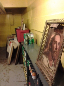 A Representation of Christ Frames the Foreground of Scene in Food Pantry