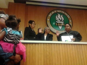 Mayor Perkins (middle) getting sworn-in by Judge Shevil Hall (right); Mrs. McNelty (left) and Mr. Perkins (background)