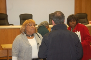 Trustee Jaycox talks with business owner