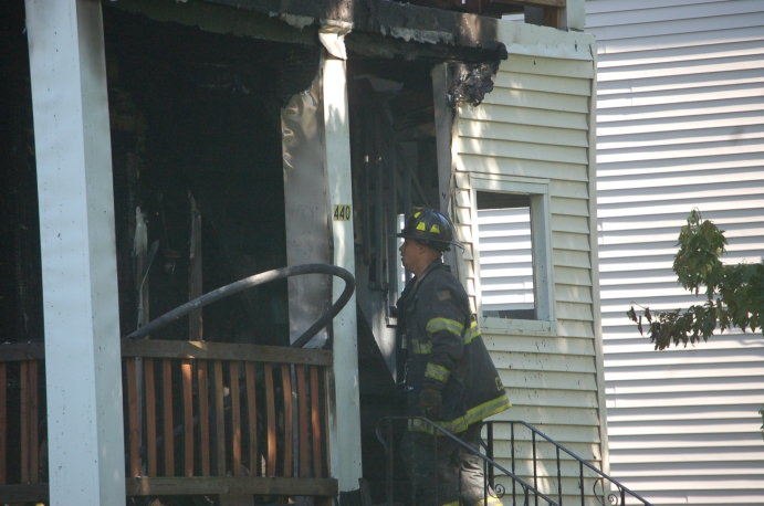Firefighter entering home