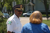 Maywood Police Chief Talley converses with Trustee Jaycox