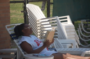Woman reads poolside