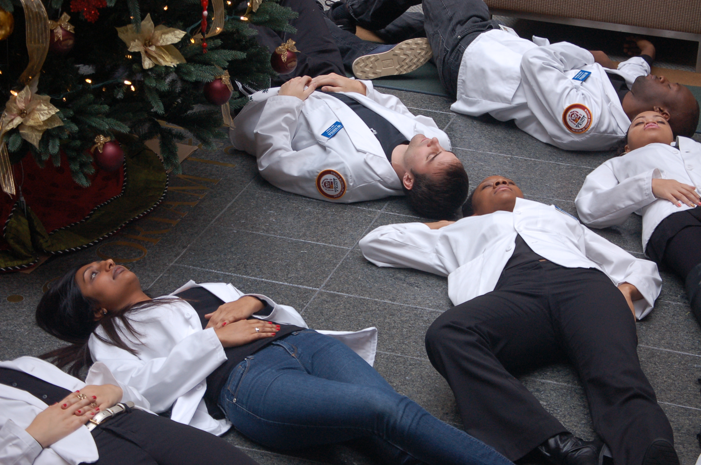 White Coats for Black Lives: Loyola Med Students Stage 'Die-in' in ...