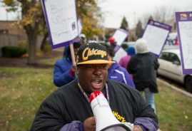 Fredrico Brown a member of SEIU pickets in front of the Jackson Square Nursing Center in the West Side of Chicago on Thursday November 12, 2015.