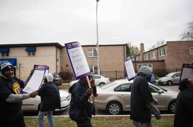 Nurses picket in front of the Jackson Square Nursing Center in the West Side of Chicago on Thursday November 12, 2015.