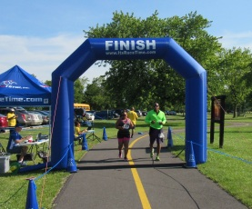 Maywood 5K couple running past finish line