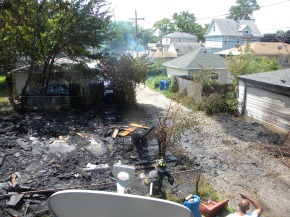 Abandoned Garage Fire Spreads, Damaging Two Properties Nearby