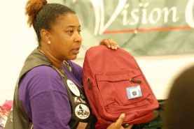 Volunteers help give away book bags on Aug. 20 in Maywood