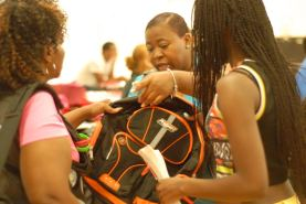 Volunteers help give away more than 2000 book bags on Aug. 20 in Maywood