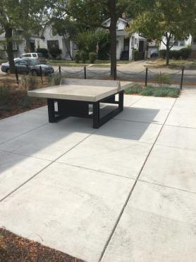 The newly renovated grounds of Maywood Park District's new central area district feature built-in chess/checkers, Ping-Pongs and platforms for playing Cornhole.
