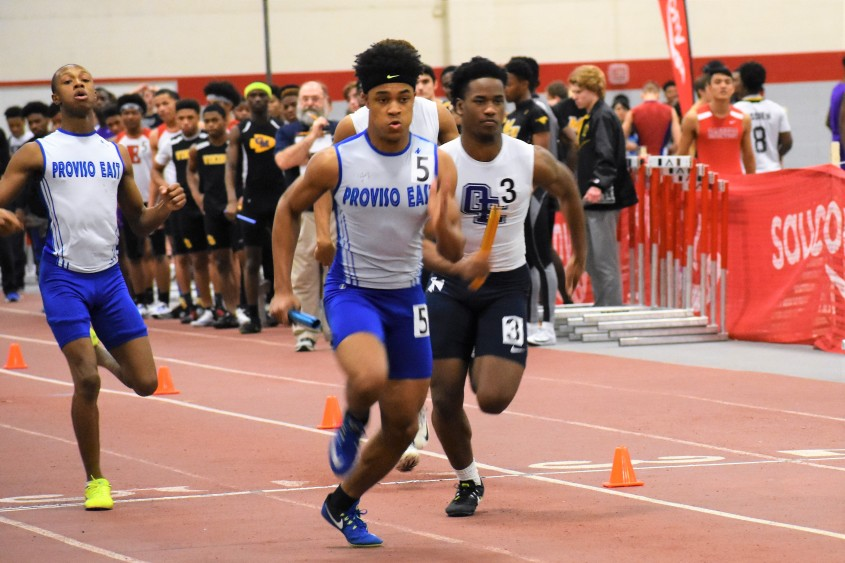 Corey Mason passes the baton to Troy Blaylock in the 4 x 200 meter relay at the 2018 Greg Foster Invitational.jpg